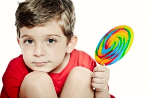 cute kid with lollipop and red tshirt